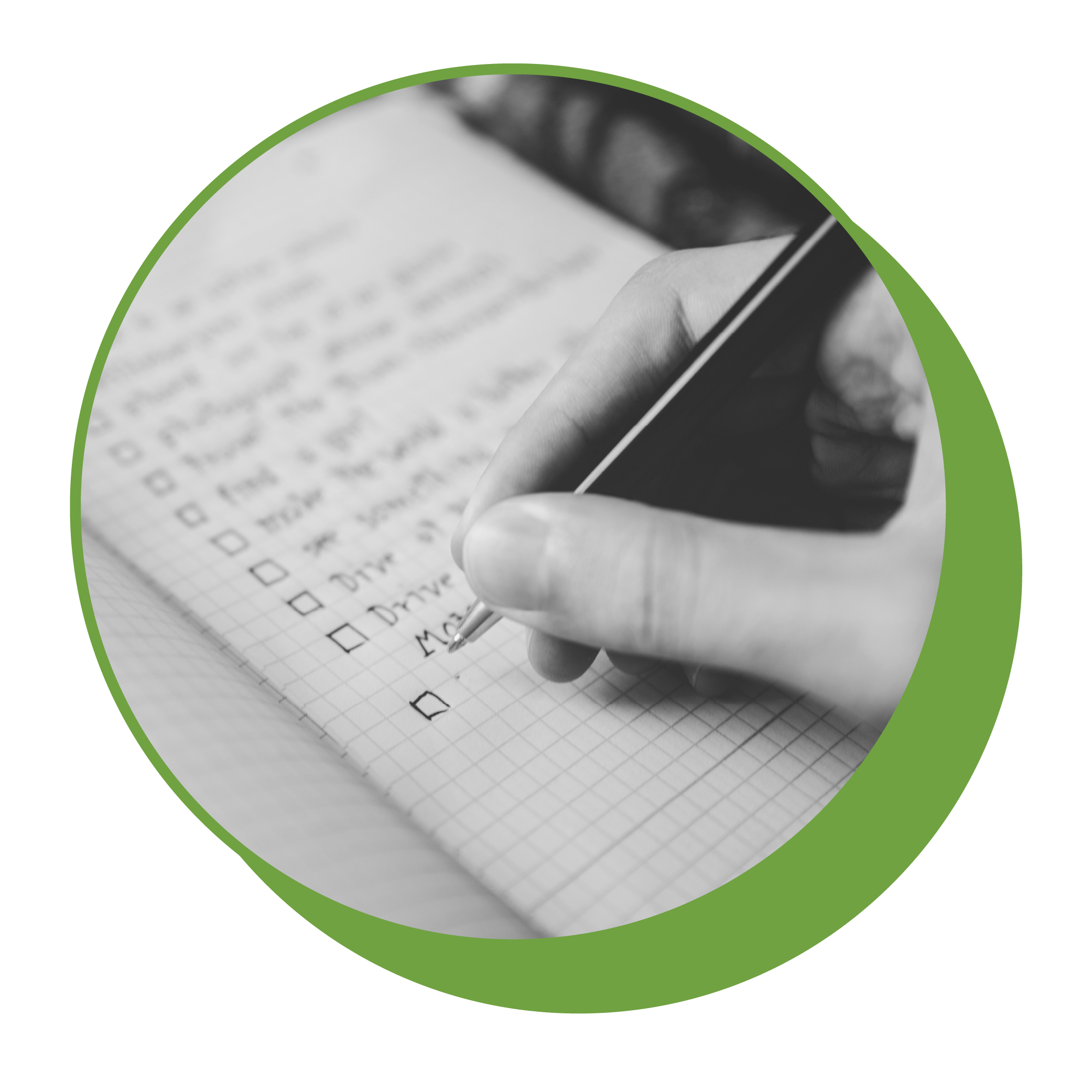 A hand holding a pen, creating a checklist in a notebook